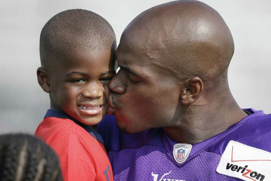 Adrian Peterson plans to plead not guilty to a charge of injury to a child today in a Conroe court. Photo: Charlie Neibergall / Associated Press / AP