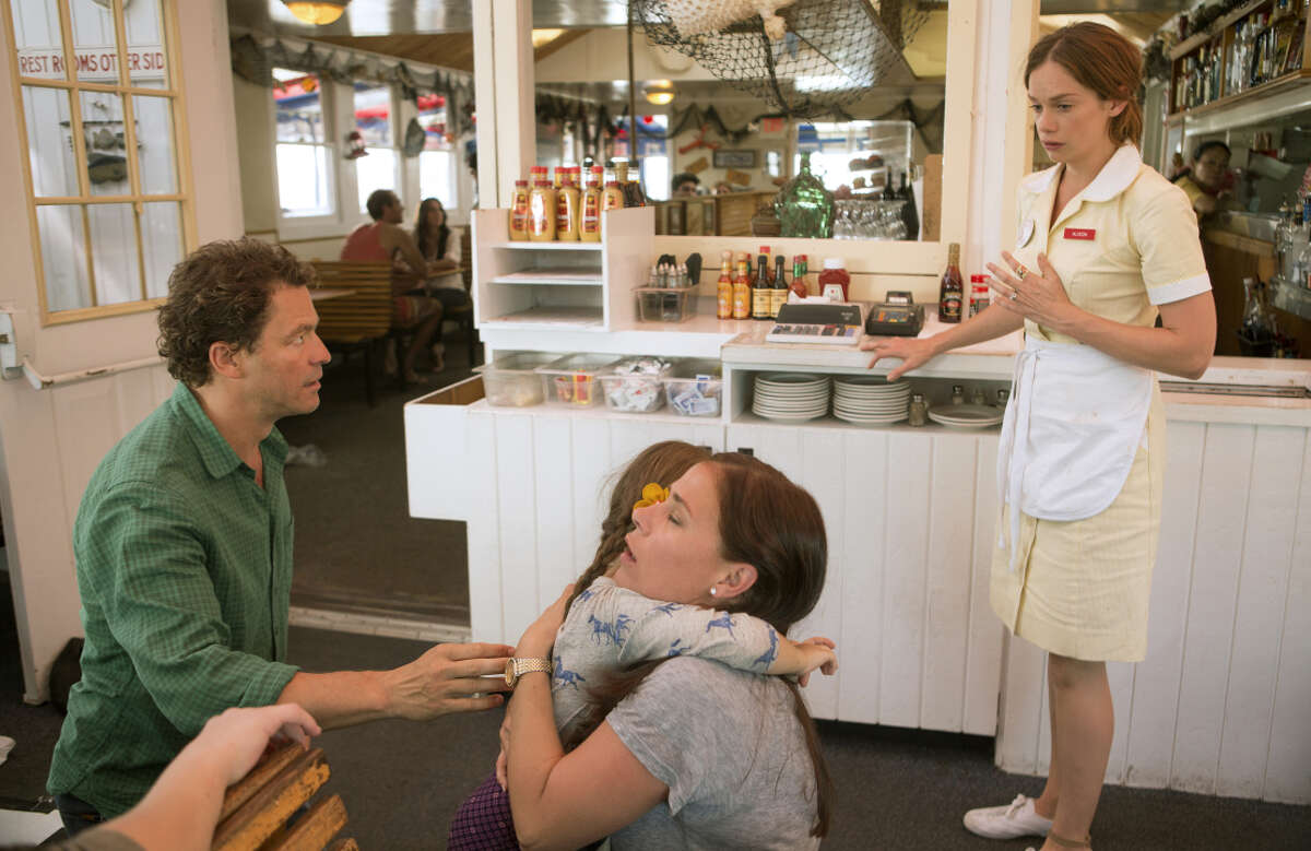 Dominic West and Maura Tierney (center) play a happily married couple, and then a waitress played by Ruth Wilson comes along.