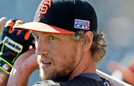 San Francisco Giants right fielder Hunter Pence warms up during batting practice before Game 3 of baseball's NL Division Series against the Washington Nationals in San Francisco, Monday, Oct. 6, 2014. (AP Photo/Ben Margot)