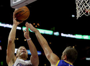 Clippers forward Blake Griffin shoots over Warriors forward David Lee during the first half of a 112-94 victory.