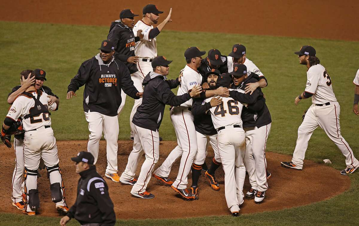 The San Francisco Giants celebrate after beating the Washington Nationals 3-2 in game four of the National League Division Series at AT&T Park in San Francisco , Calif., on Tuesday Oct. 7, 2014.