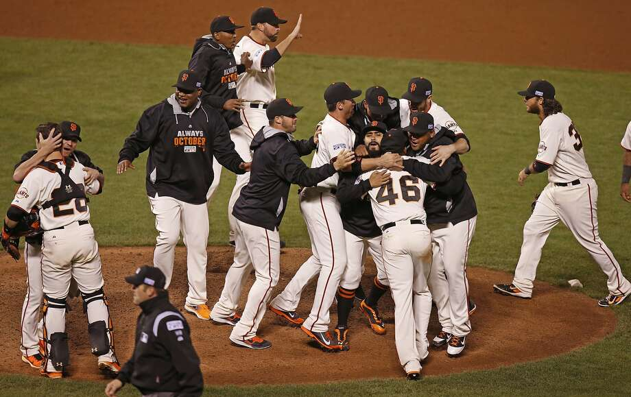 The San Francisco Giants celebrate after beating the Washington Nationals 3-2 in game four of the National League Division Series at AT&T Park in San Francisco , Calif., on Tuesday Oct. 7, 2014. Photo: Michael Macor, The Chronicle