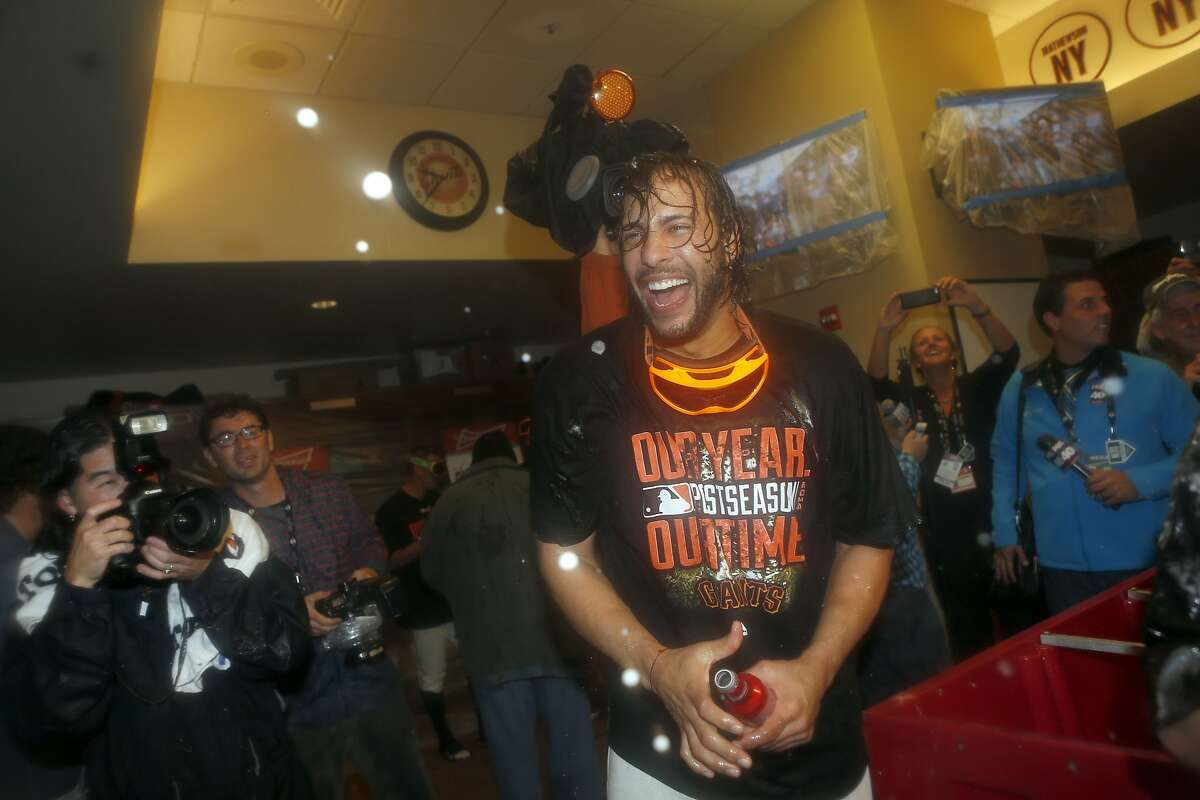 Giant Michael Morse celebrates the teams 3 to 2 win over the Washington Nationals in Game 4 of the NLDS at AT&T Park on Tuesday, Oct. 7, 2014 in San Francisco, Calif.