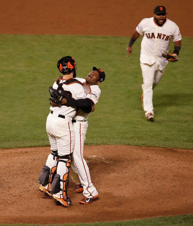 Catcher Buster Posey is lifted by closing pitcher Santiago Casilla after the San Francisco Giants beat the Washington Nationals 3-2 in game four of the National League Division Series at AT&T Park in San Francisco , Calif., on Tuesday Oct. 7, 2014. Photo: Michael Macor / The Chronicle / ONLINE_YES