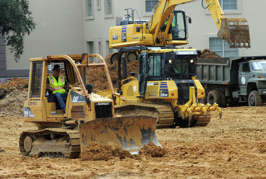 Earth moving began in September on the planned H-E-B at College and 11th Streets. A big-box competitor is also looking to move into the same area.   Photo taken Wednesday, September 17, 2014 Guiseppe Barranco/@spotnewsshooter Photo: Guiseppe Barranco, Photo Editor