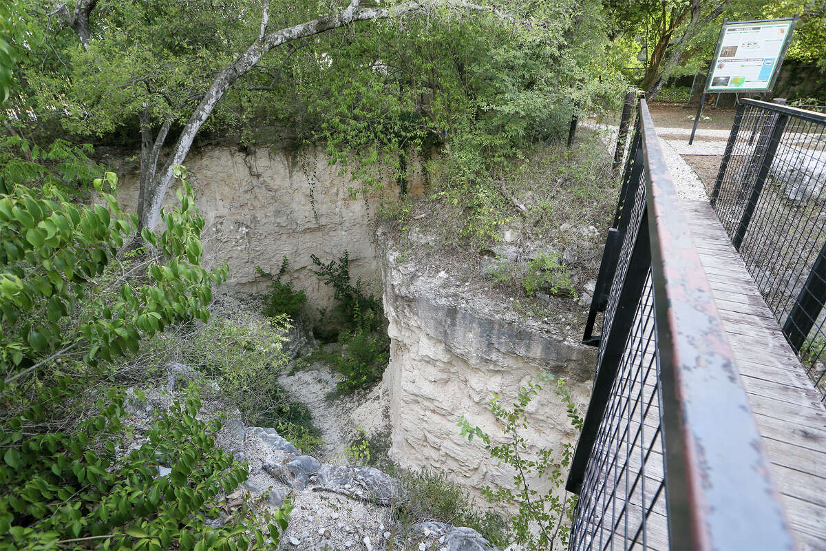 The original entrace at the bottom of the sinkhold at Robber Baron Cave on Wednesday, Sept. 24, 2014. Robber Baron Cave, at the corner of Nacogdoches Rd. and Camellia Dr., is the longest and one of the most significant caves in Bexar County with one mile of mapped passage. Photo by Marvin Pfeiffer / EN Communities