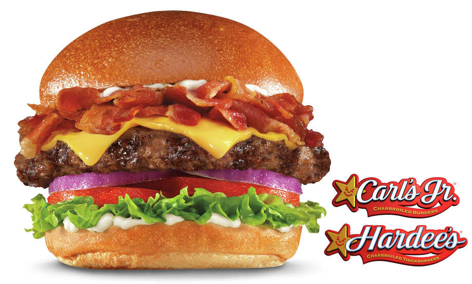 The Mile High Bacon Cheese Thickburger at Carl's Jr. has 1,190 calories. The breakdown:  a ½-pound charbroiled beef patty topped with American cheese, red onion, lettuce, tomato, mayo and 1.5 ounces of bacon on a fresh-baked bun. Fat grams: 80. Sodium: 2,650 mg. Carbs: 60 g. Dietary fiber: 4 g. Protein: 59 g. Photo: --
