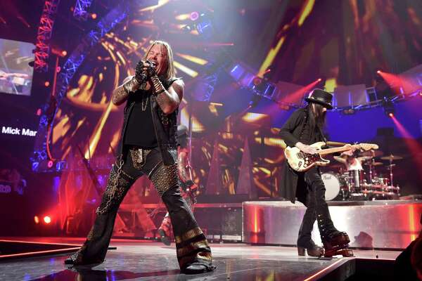 LAS VEGAS, NV - SEPTEMBER 19: Recording artists Vince Neil (L) and Mick Mars of the band Motley Crue perform onstage during the 2014 iHeartRadio Music Festival at the MGM Grand Garden Arena on September 19, 2014 in Las Vegas, Nevada. (Photo by Kevin Winter/Getty Images for Clear Channel)