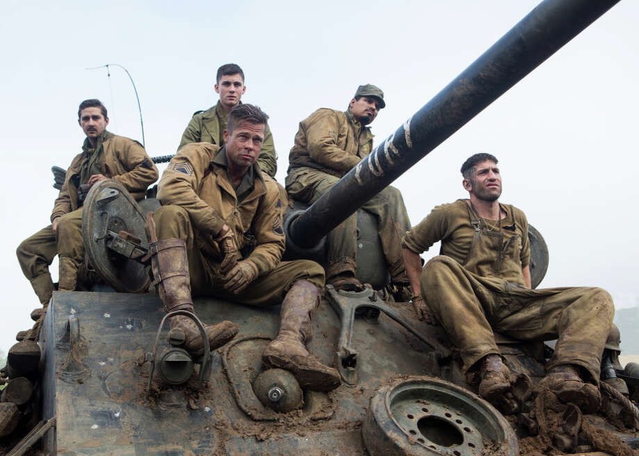 """Brad Pitt (front left) plays an Army sergeant who commands a Sherman tank crew in the World War II drama, """"Fury."""" Photo: Giles Keyte / Associated Press / Sony Pictures Entertainment"""