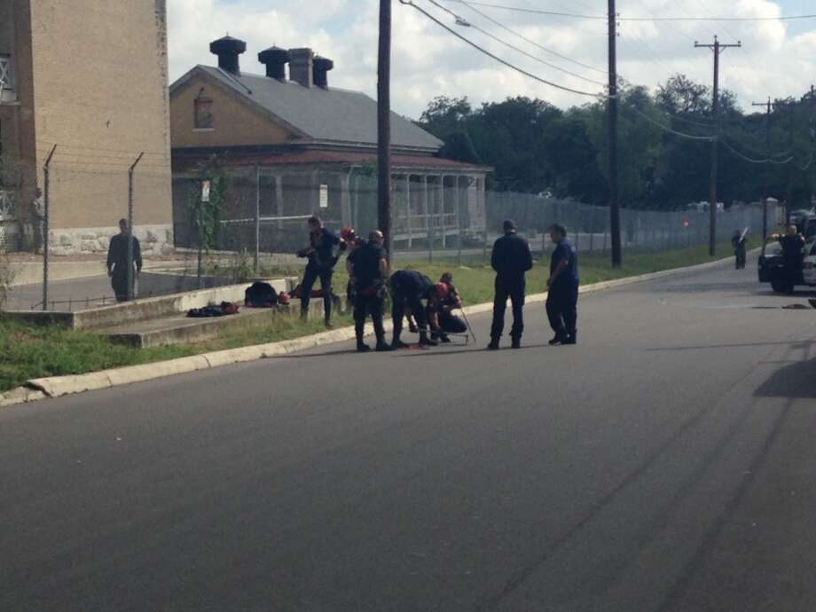 San Antonio police and firefighters spent more than an hour trying to get a woman who is believed to be a psychiatric patient out of a drainage pipe just outside of Ft. Sam Houston on Oct. 8, 2014. Photo: Mark D. Wilson/San Antonio Express-News