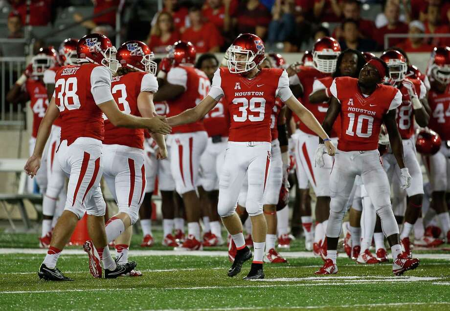 HOUSTON, TX - OCTOBER 02:  Kyle Bullard #39 of the Houston Cougars celebrates with his teammates after kicking a 51-yard field goal in the third quarter of the game against the UCF Knights at TDECU Stadium  on October 2, 2014 in Houston, Texas. Photo: Scott Halleran, Getty Images / 2014 Getty Images