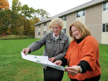 Dana Ford, left, principal of Schaghticoke Middle School in New Milford, and Wendy LaCava, former PTO president, discuss school facilities in this file photo. The school's roof needs to be replaced soon, officials said.