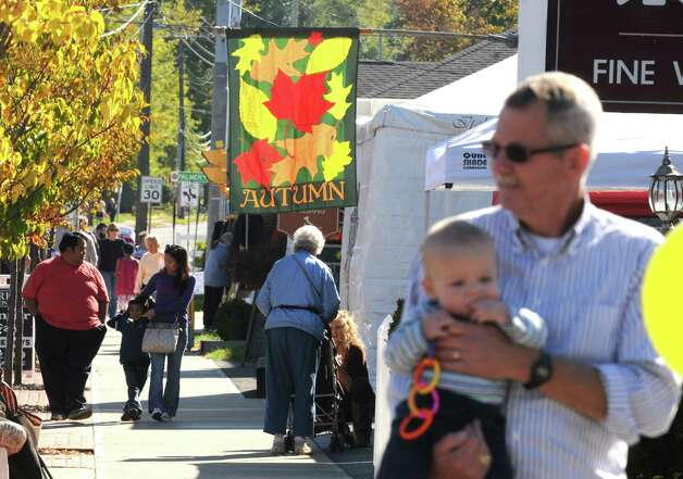 A beautiful mix of sun and shade during the upper Union Street Schenectadya€™s 8 th Annual Harvest Fest & Art Show on Saturday Oct. 12, 2013 in Schenectady, N.Y. (Michael P. Farrell/Times Union) Photo: Michael P. Farrell / 00023965A