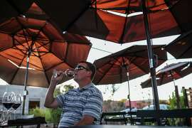 Trevor Richards enjoys a glass of wine in the outdoor tasting area at St. Claire Brown Winery in Napa on October 1st 2014.