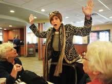 """U.S. Rep. Rosa DeLauro reacts with surprise when constituent Elaine Matto, left, of Shelton, tells her that her mother just turned 100 years old, during DeLauro's """"Rosa on the Road"""" visit to the Riverdale Diner in Shelton, Conn. on Wednesday, October 8, 2014."""