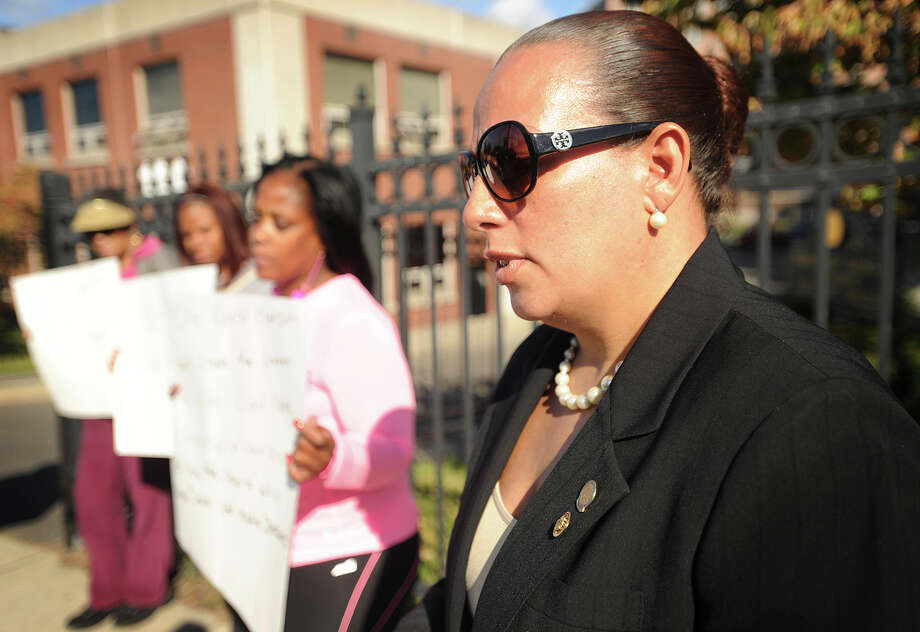 City council member Eneida Martinez-Walker, right, stands with protesters outside Bridgeport Housing Authority headquarters calling for the replacement of the Housing Authority board on Highland Avenue in Bridgeport, Conn. on Wednesday, October 8, 2014. Photo: Brian A. Pounds / Connecticut Post