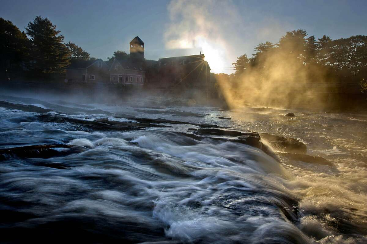Ay-yuh, the frost is on the pumpkin and the steam is on the river: Vapor rises over the Royal River as it flows past Sparhawk Mill on a chilly autumn morning in Yarmouth, Maine.
