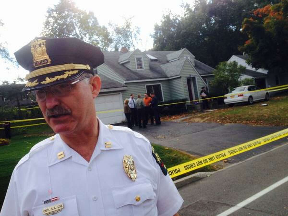 Guilderland Police Capt. Curtis Cox briefs the media Wednesday about a quadruple homicide at 1846 Western Ave. (Cindy Schultz / Times Union)