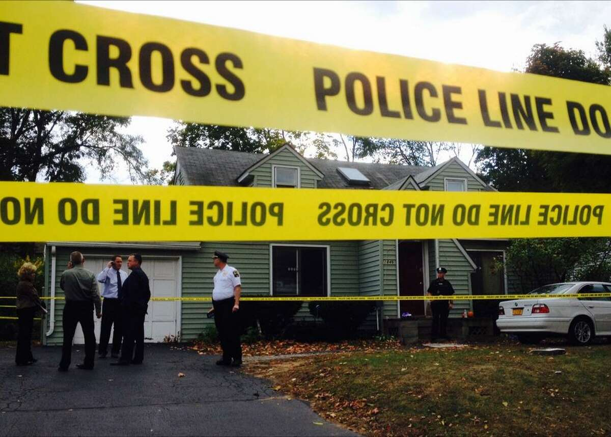 Police gather Wednesday at 1846 Western Ave., Guilderland where four people were found dead. (Skip Dickstein / Times Union)