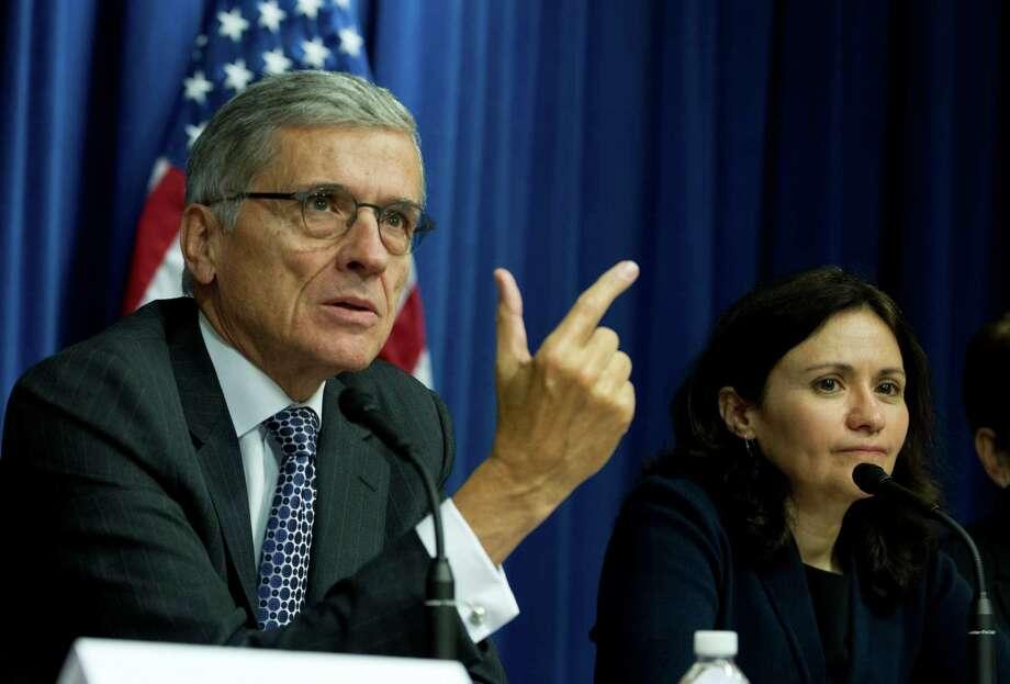 FCC Chairman Tom Wheeler and FTC Chairwoman Edith Ramirez discuss cramming fines last year. Photo: Jose Luis Magana / Associated Press / FR159526 AP