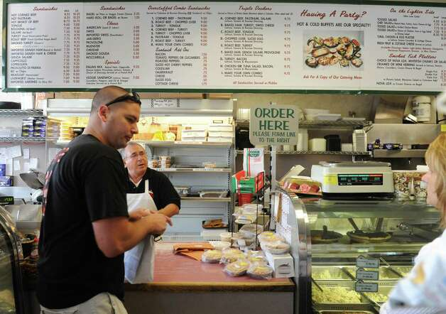 Tony Lauria, owner, behind the counter at Gershon's Deli on Thursday Oct. 2, 2014 in Schenectady, N.Y.  (Michael P. Farrell/Times Union) Photo: Michael P. Farrell / 00028858A