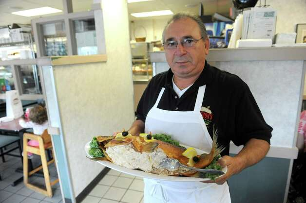 Tony Lauria owner of  Gershon's Deli hold a smoked white fish platter on Thursday Oct. 2, 2014 in Schenectady, N.Y.  (Michael P. Farrell/Times Union) Photo: Michael P. Farrell / 00028858A