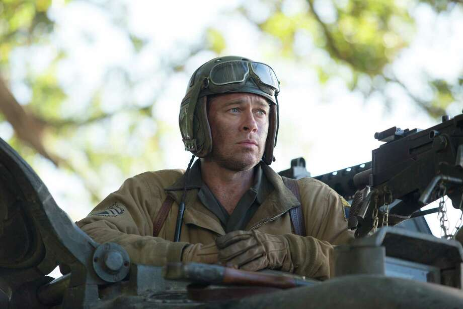 """Brad Pitt in the World War II film """"Fury"""": Tanks, but no tanks, says one reader. Photo: Giles Keyte / Associated Press / Sony Pictures Entertainment"""