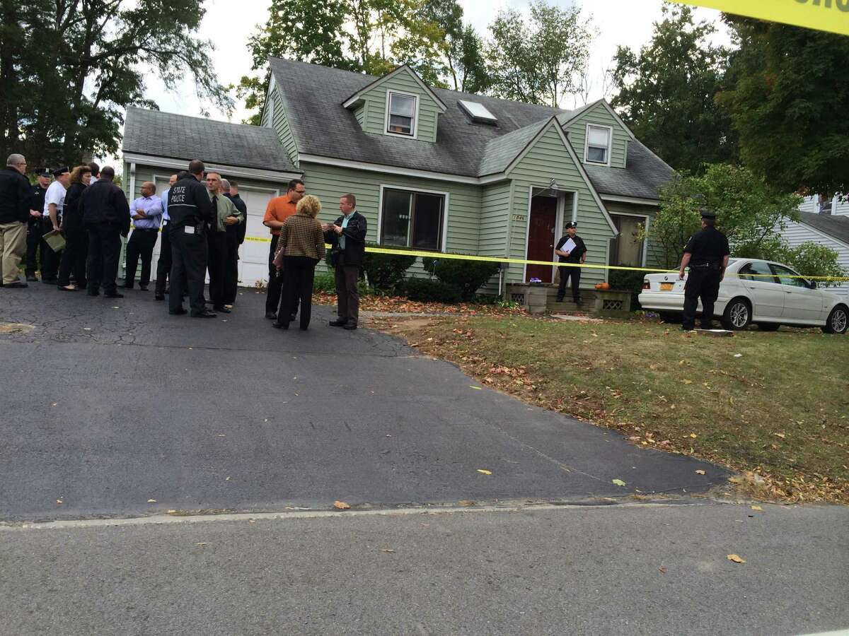 Police and prosecutors gather at 1846 Western Ave., Guilderland where four people were found dead on Wednesday. (Skip Dickstein / Times Union)