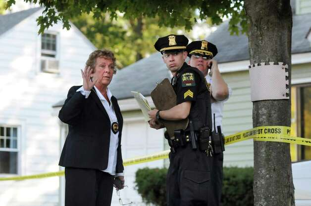 Guilderland Police Chief Carol Lawlor, left, talks with police officers  at the scene of a quadruple homicide at 1846 Western Ave. on Wednesday, Oct. 8, 2014, in Guilderland, N.Y. (Cindy Schultz / Times Union) Photo: Cindy Schultz / 10028968A
