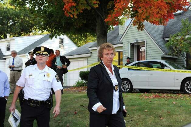 Guilderland Police Chief Carol Lawlor, right, and Lt. Daniel McNally, left, at the scene of a quadruple homicide at 1846 Western Ave. on Wednesday, Oct. 8, 2014, in Guilderland, N.Y. (Cindy Schultz / Times Union) Photo: Cindy Schultz / 10028968A