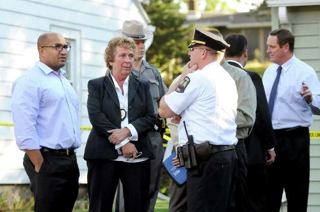 Albany County District Attorney David Soares, left, and Guilderland Police Chief Carol Lawlor, second from left, speak with Lt. Daniel McNally, center, at the scene of a quadruple homicide at 1846 Western Ave. on Wednesday, Oct. 8, 2014, in Guilderland, N.Y. (Cindy Schultz / Times Union) Photo: Cindy Schultz / 10028968A