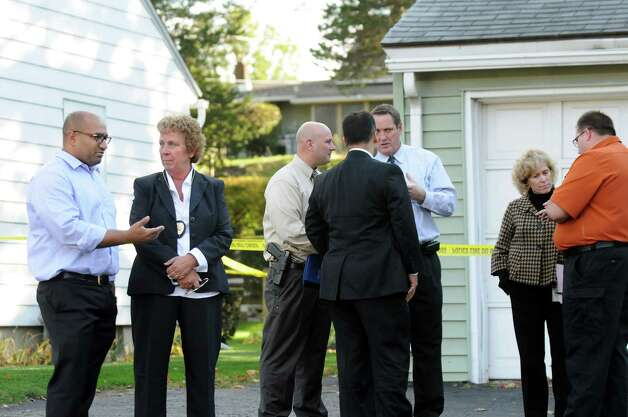 Albany County District Attorney David Soares, left, speaks with Guilderland Police Chief Carol Lawlor, second from left, at the scene of a quadruple homicide at 1846 Western Ave. on Wednesday, Oct. 8, 2014, in Guilderland, N.Y. (Cindy Schultz / Times Union) Photo: Cindy Schultz / 10028968A