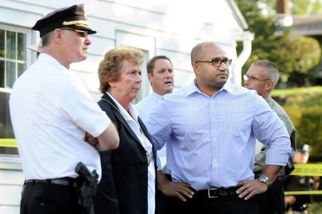 Guilderland Capt. Curtis Cox, left, Guilderland Police Chief Carol Lawlor, second from left, and Albany County District Attorney David Soares, center,  at the scene of a quadruple homicide at 1846 Western Ave. on Wednesday, Oct. 8, 2014, in Guilderland, N.Y. (Cindy Schultz / Times Union) Photo: Cindy Schultz / 10028968A