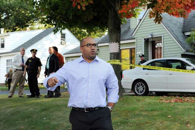 Albany County District Attorney David Soares, center, at the scene of a quadruple homicide at 1846 Western Ave. on Wednesday, Oct. 8, 2014, in Guilderland, N.Y. (Cindy Schultz / Times Union) Photo: Cindy Schultz / 10028968A