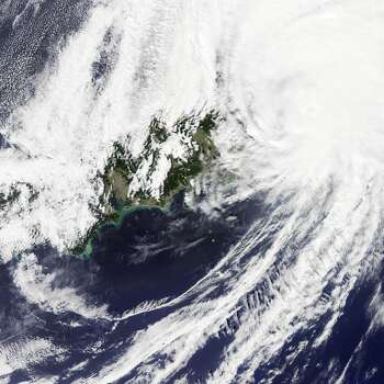 Typhoon Phanfone barreled into southern Japan at about 8 a.m. local time on Oct. 6 (11 p.m. Universal Time on Oct. 5). The category 1 storm made landfall in Shizuoka Prefecture with maximum sustained winds of about 80 miles per hour.  Phanfone dumped 19 inches of rain in the mountainous region of Shizuoka Prefecture. At one point during the storm, rain fell in Shizuoka—the capital city of the prefecture—at a record-rate of 3.4 inches per hour. The 667,000 people living in the prefecture were urged to evacuate to safer ground.  The intense rain and resulting runoff led to sediment plumes in Suruga Bay, visible in the natural-color image (top) acquired Oct. 6 by the Moderate Resolution Imaging Spectroradiometer (MODIS) on NASA's Aqua satellite. Photo: NASA, Jesse Allen