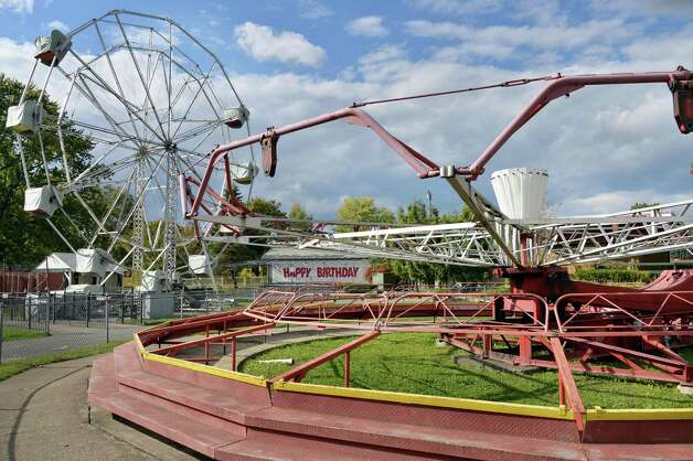 Rides at Hoffman's Playland await dismantling as the announcement that the park will move to property adjacent to Huck Finn's Warehouse in Albany during a news conference Wednesday Oct. 8, 2014, in Colonie, NY.  (John Carl D'Annibale / Times Union) Photo: John Carl D'Annibale / 10028954A