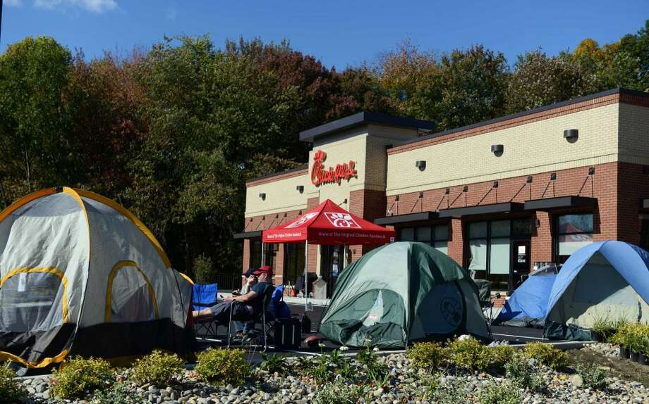 Customers camp out in front of the Chick-fil-A in Brookfield, Conn., to be among the first 100 diners  and be awarded a free meal once a week for a year, Wednesday, Oct. 8, 2014. The restaurant opened at 6 am Thursday, Oct. 9, 2014 and is the first in the state. Photo: Autumn Driscoll