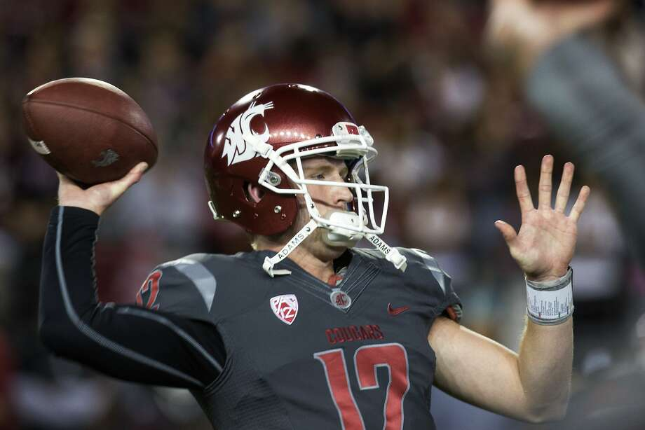 Washington State quarterback Connor Halliday (12) warms up before the start of an NCAA college football game against California on Saturday, Oct. 4, 2014, at Martin Stadium in Pullman, Wash. Halliday set an NCAA FBS single game record with 734 yards passing and six touchdowns. California won 60-59. (AP Photo/Dean Hare) Photo: Dean Hare, Associated Press