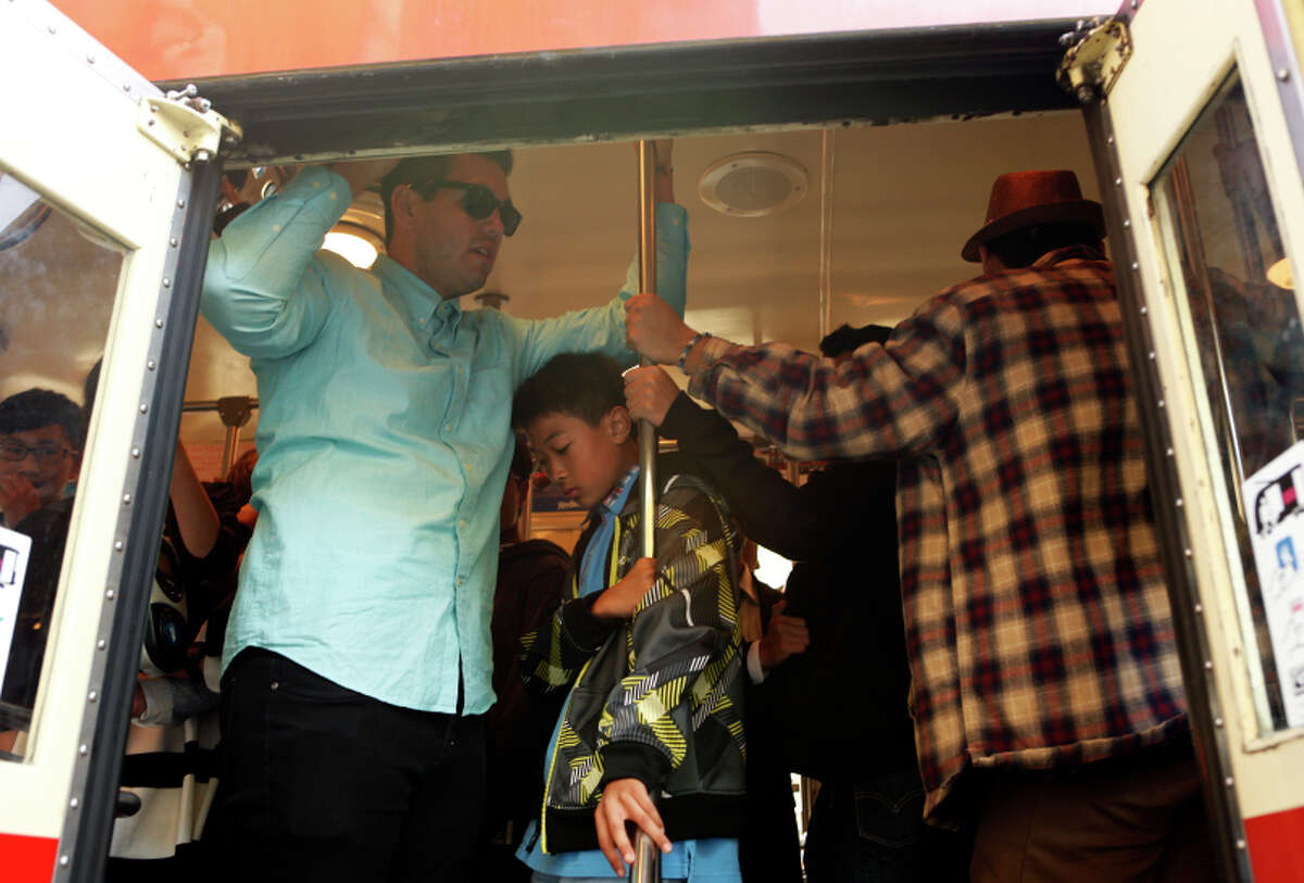 Muni riders squeeze onto a typically jammed streetcar on Market Street. City residents wonder if there's a solution.