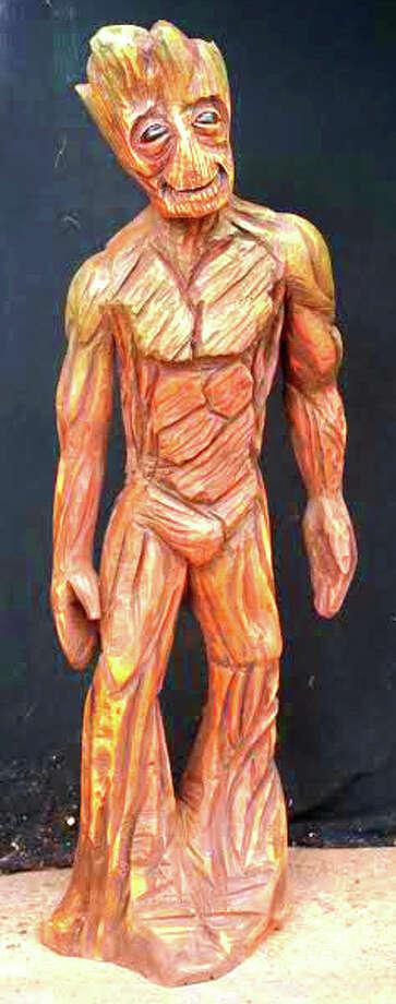 Texas woman carves wooden sculpture of marvel comics