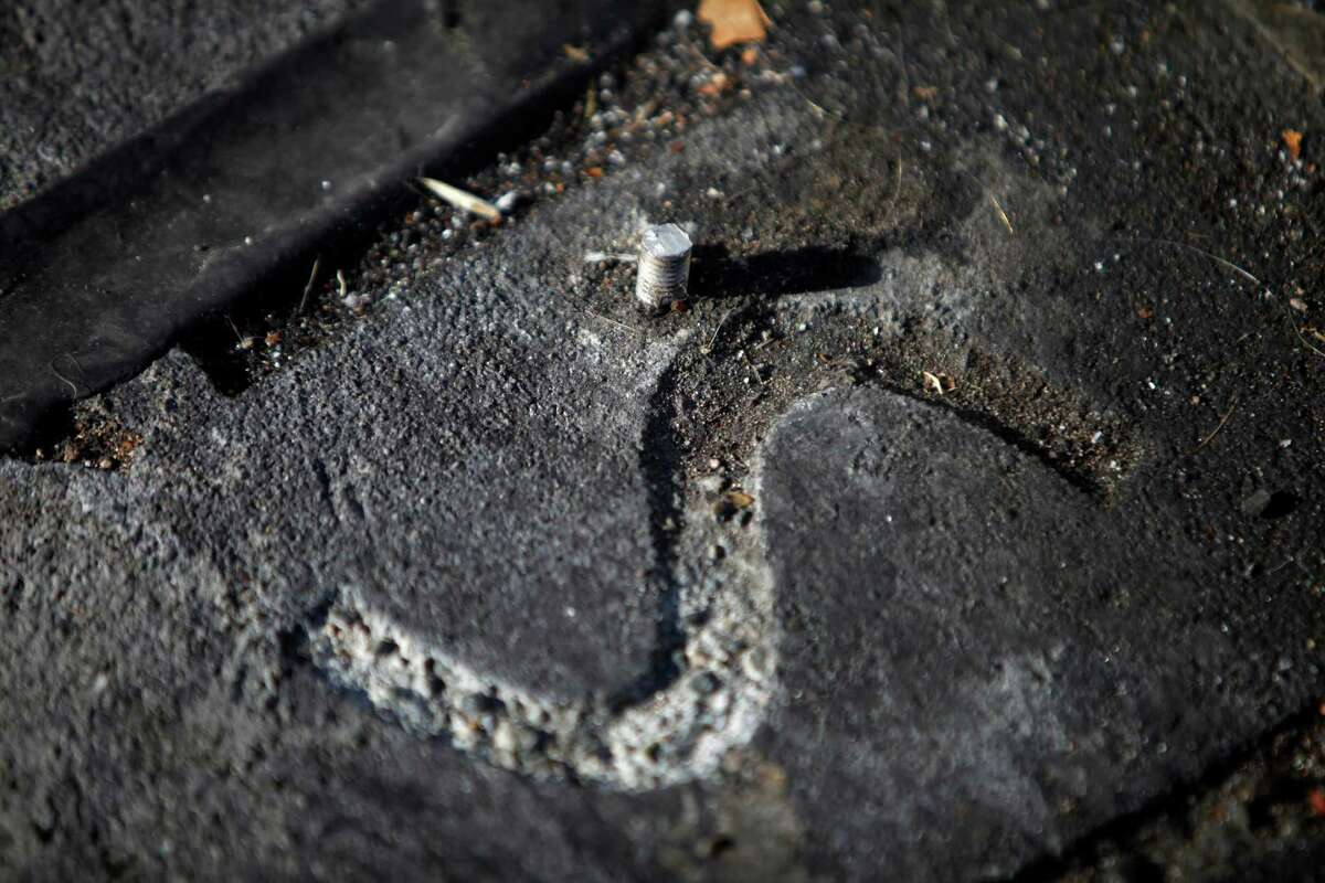 A bolt sticks out of the ground where a bench used to be at a plaza on Mission Street and Cesar Chavez Street on Wednesday, October 8, 2014 in San Francisco, Calif.