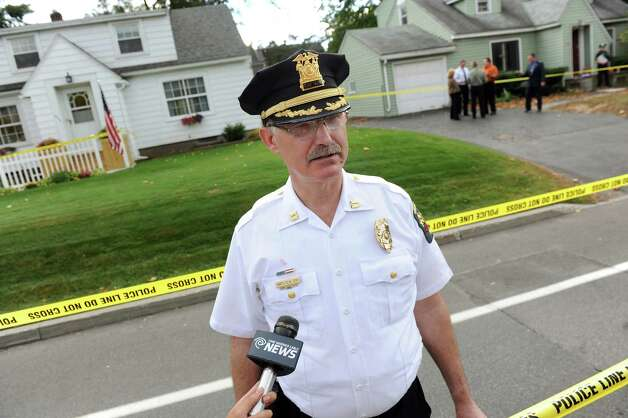 Guilderland Police Capt. Curtis Cox, center, briefs the media at the scene of a quadruple homicide at 1846 Western Ave. on Wednesday, Oct. 8, 2014, in Guilderland, N.Y. (Cindy Schultz / Times Union) Photo: Cindy Schultz / 10028968A
