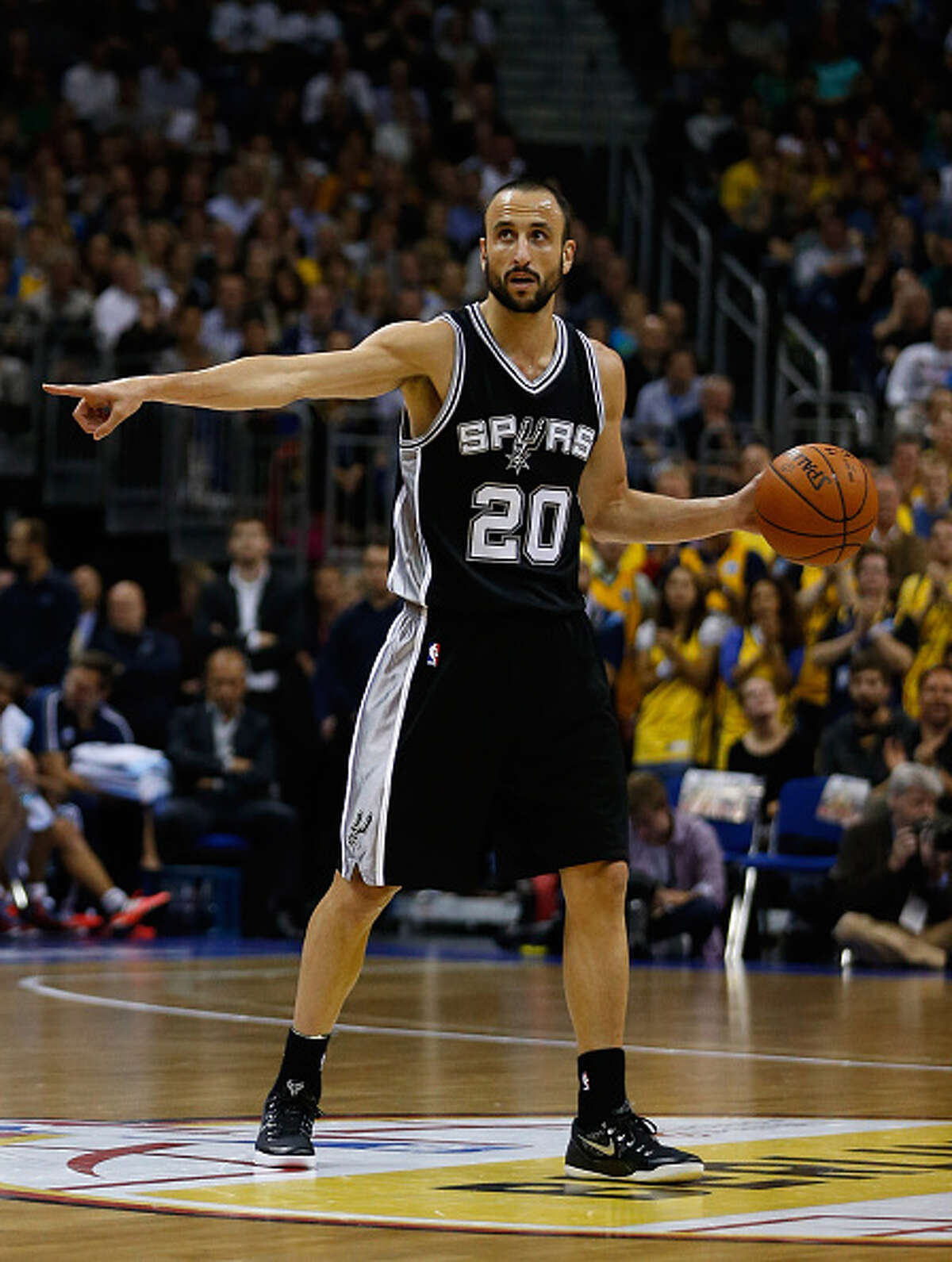 BERLIN, GERMANY - OCTOBER 08: Manu Ginobili of San Antonio in action during the NBA Global Games Tour 2014 match between Alba Berlin and San Antonio Spurs at O2 World on October 8, 2014 in Berlin, Germany.