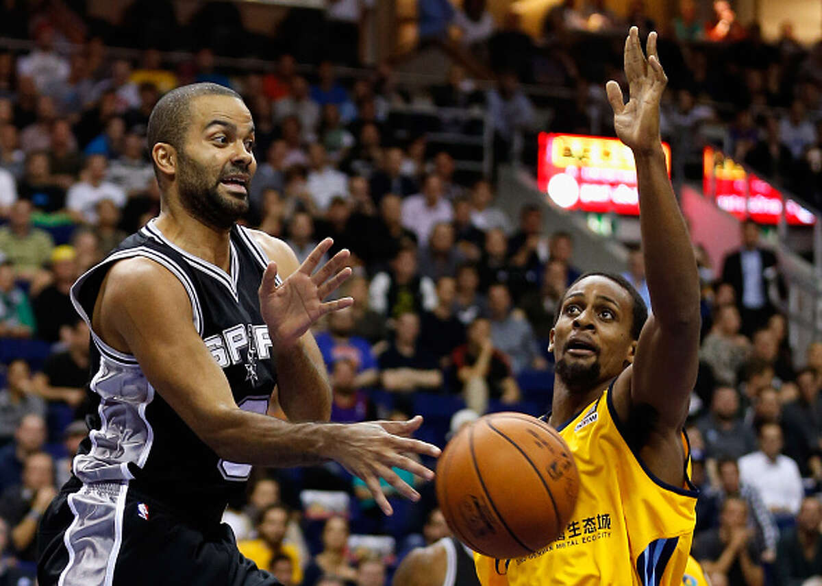BERLIN, GERMANY - OCTOBER 08: Tony Parker (L) of San Antonio is challenged by Clifford Hammonds of Berlin during the NBA Global Games Tour 2014 match between Alba Berlin and San Antonio Spurs at O2 World on October 8, 2014 in Berlin, Germany.