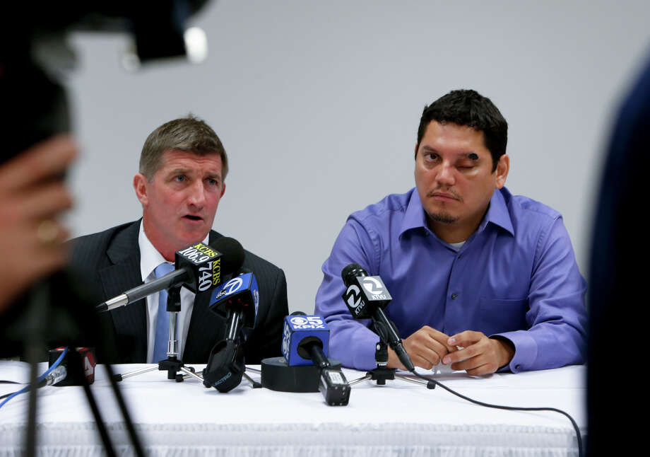 Uber passenger Roberto Chicas, (right) appears with attorney Harry Stern at a press conference. Chicas, who was allegedly attacked by a driver with a hammer, says he might lose vision in his left eye or the eye itself. Photo: Michael Macor / The Chronicle / ONLINE_YES