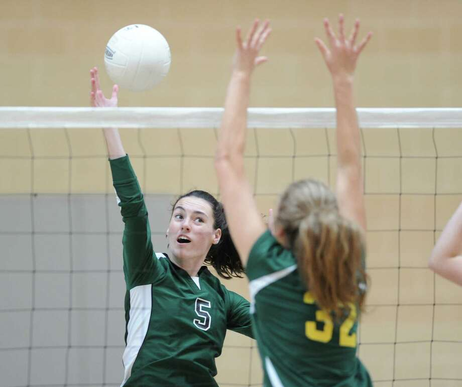 At left, Convent's Claire O'Neill (#5) gets her shot  past Greenwich Academy's Clare Ryan (#32) during the girls high school volleyball match between Convent of the Sacred Heart and Greenwich Academy at Brunswick School in Greenwich, Conn., Wednesday, Oct. 8, 2014. Convent of the Sacred Heart defeated Greenwich Academy, 3-0. Photo: Bob Luckey / Greenwich Time