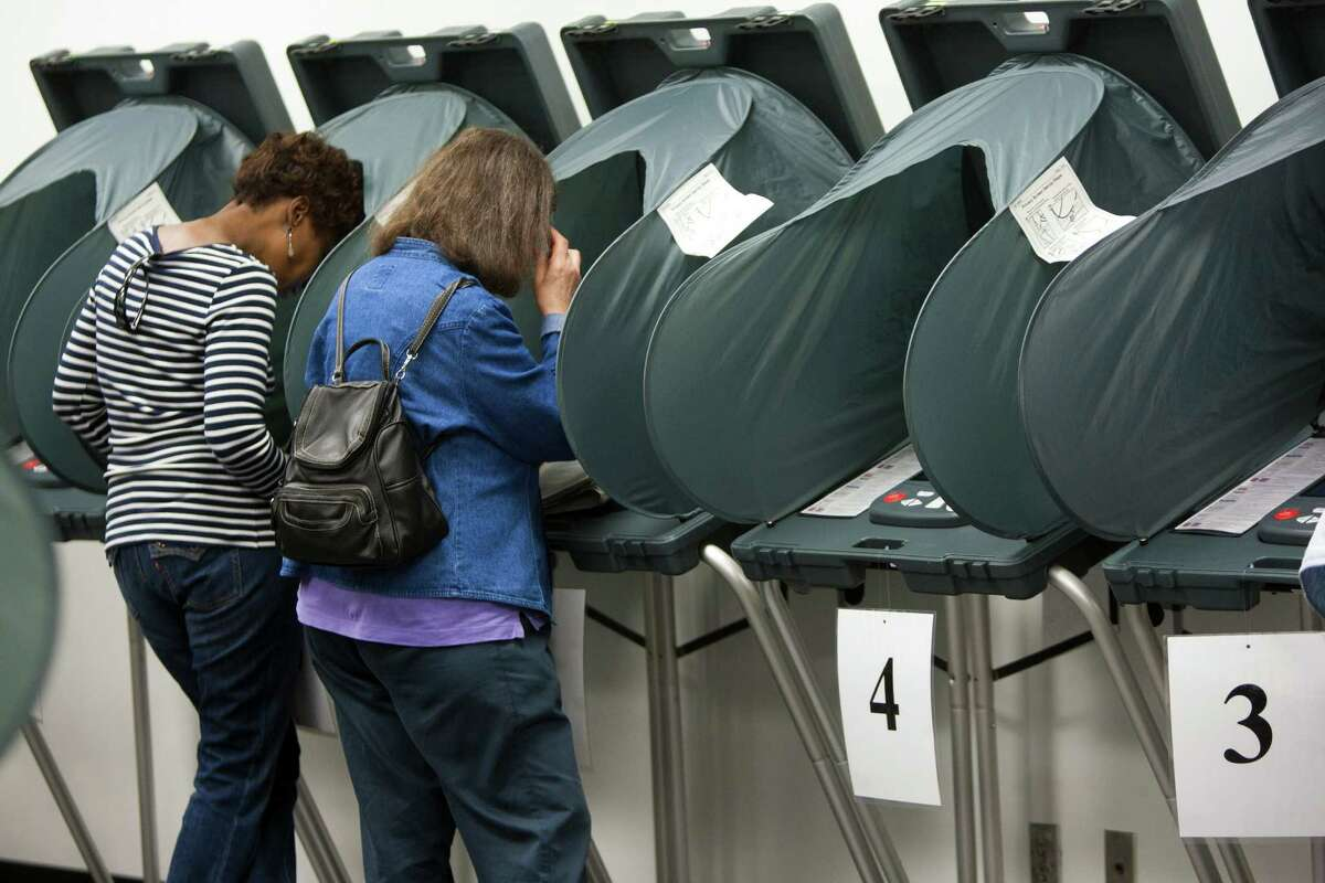 Voters cast ballots at the Harris County Courthouse in Pasadena on Nov. 1, 2013. ( Marie D. De Jeséºs / Houston Chronicle )
