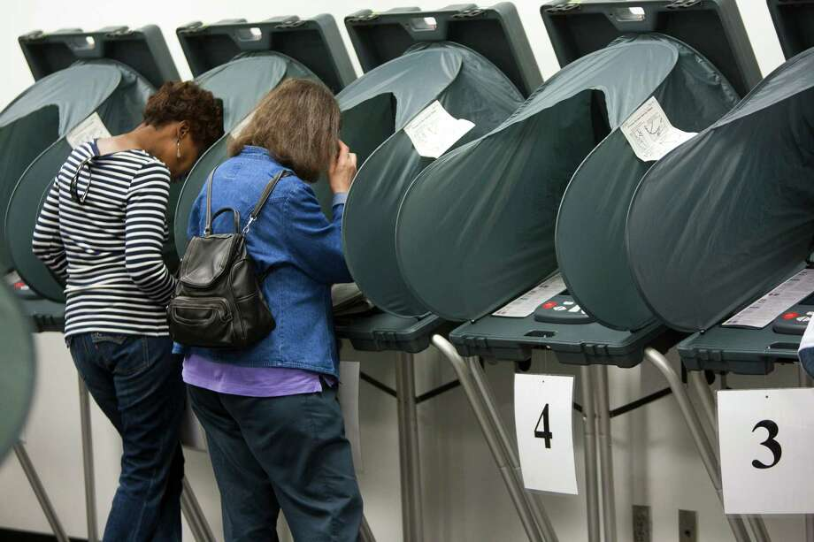 Voters cast ballots at the Harris County Courthouse in Pasadena on Nov. 1, 2013. ( Marie D. De Jeséºs / Houston Chronicle ) Photo: Marie D. De Jeséºs, Staff / © 2013 Houston Chronicle