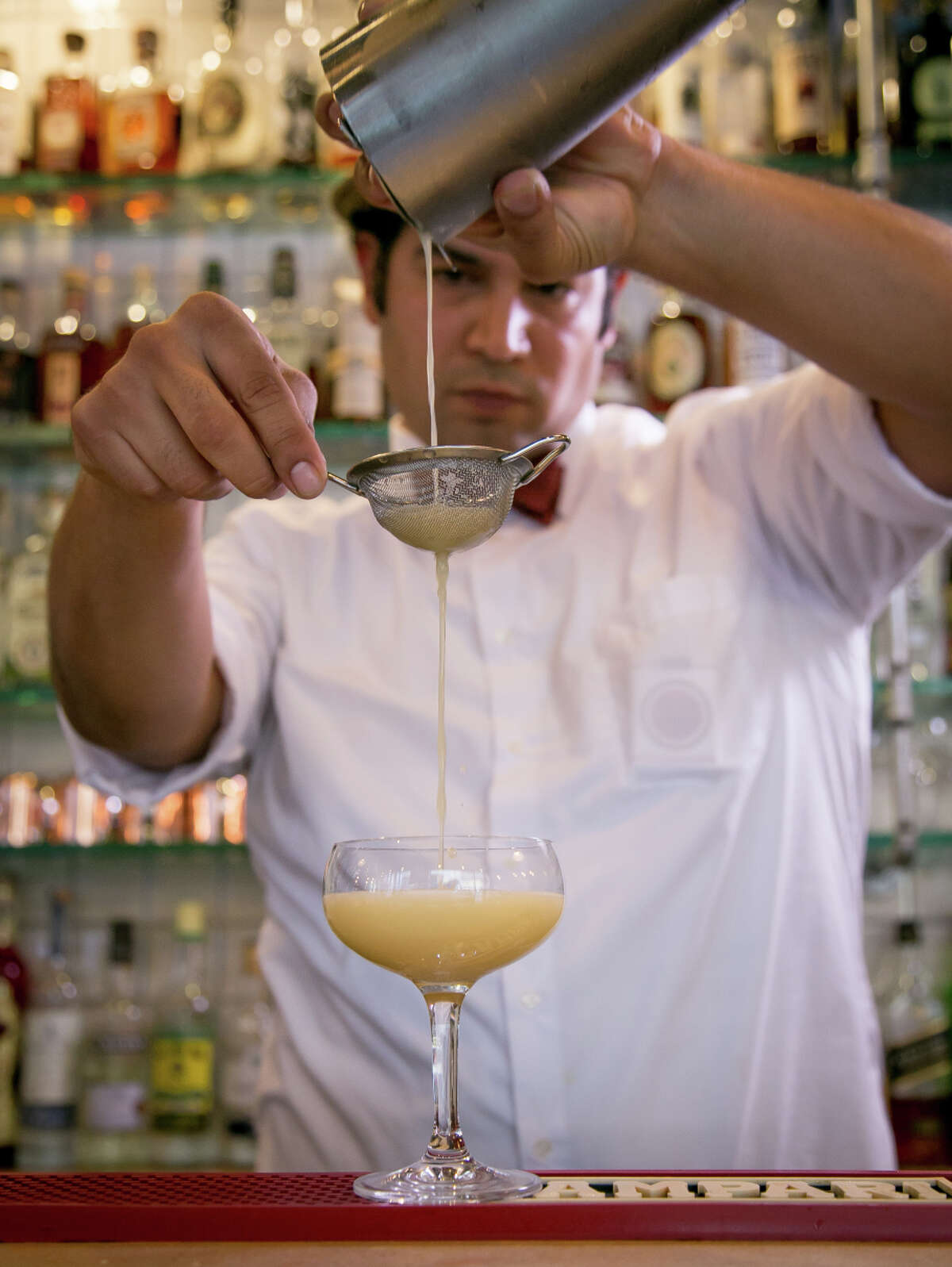 Bartender Will Herrera makes the Royal Absinthe Punch at Cafe Terminus in the Financial District of San Francisco.