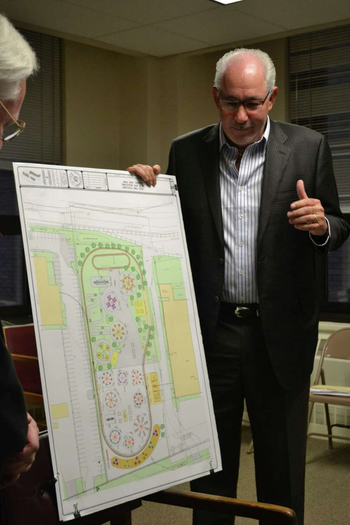 Jeff Sperber presents his plans for Huck Finn's Playland Wednesday night to the Albany County Industrial Development Agency. (Keshia Clukey/ Times Union)
